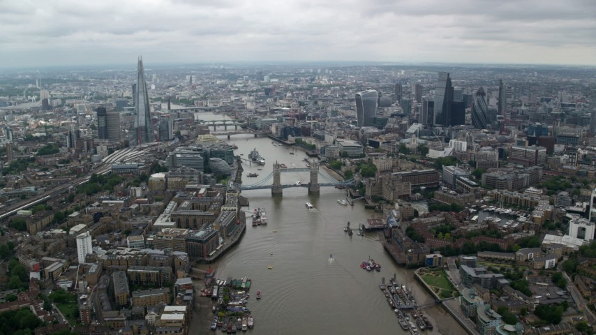 6K stock footage aerial video of Central London city sprawl and Tower Bridge over River Thames, England Aerial Stock Footage AX114_053