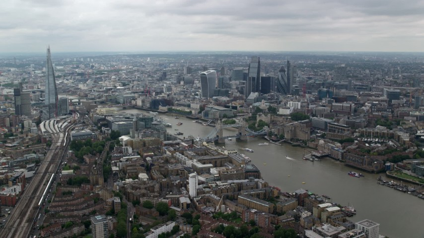 6K stock footage aerial video of Central London skyscrapers and city sprawl around Tower Bridge and River Thames, England Aerial Stock Footage | AX114_056