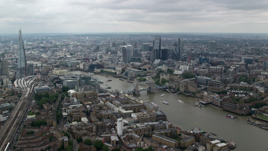 6K stock footage aerial video approach Tower Bridge spanning River Thames by Central London skyscrapers, England Aerial Stock Footage | AX114_057