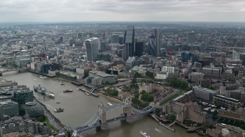 6K stock footage aerial video of Tower Bridge and Tower of London near skyscrapers in Central London, England Aerial Stock Footage | AX114_059
