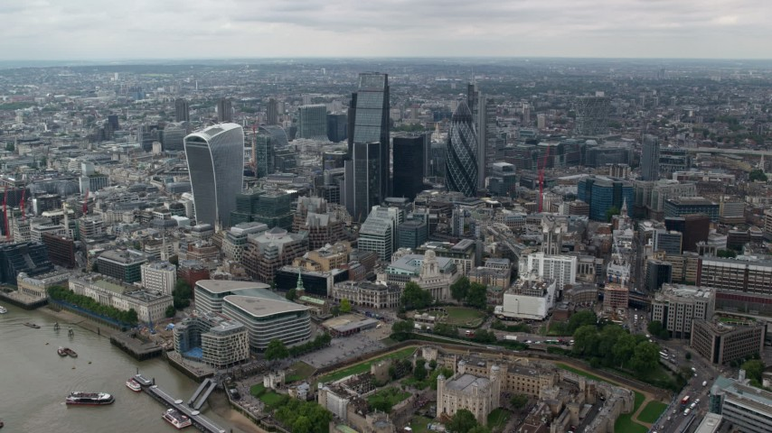6K stock footage aerial video of approaching skyscrapers from River Thames, Central London, England Aerial Stock Footage | AX114_060