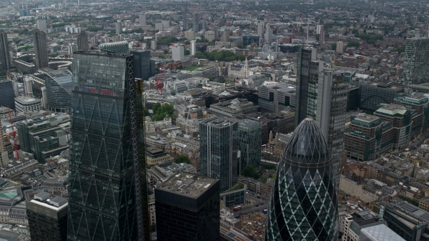 6K stock footage aerial video fly between The Gherkin and Leadenhall Building skyscrapers, Central London, England Aerial Stock Footage | AX114_063