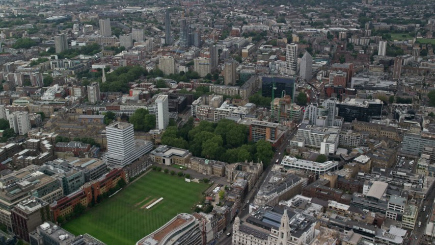 6K stock footage aerial video fly over Artillery Ground cricket field and office buildings, Central London, England Aerial Stock Footage   AX114_065