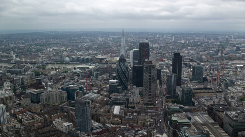 6K stock footage aerial video approaching The Gherkin skyscraper with view of The Shard, Central London, England Aerial Stock Footage | AX114_071