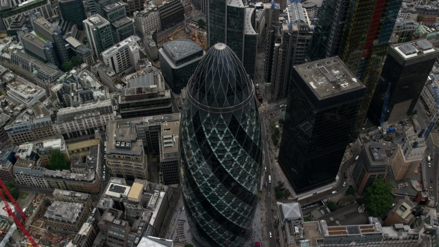 6K stock footage aerial video of tilting to a bird's eye view of The Gherkin skyscraper, Central London, England Aerial Stock Footage | AX114_074