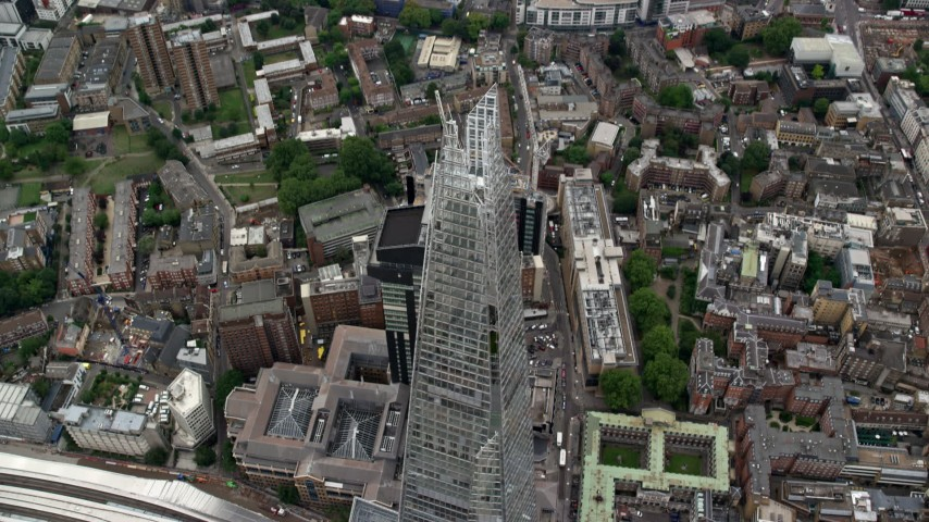 6K stock footage aerial video of tilt to bird's eye of The Shard skyscraper in  London, England Aerial Stock Footage | AX114_079
