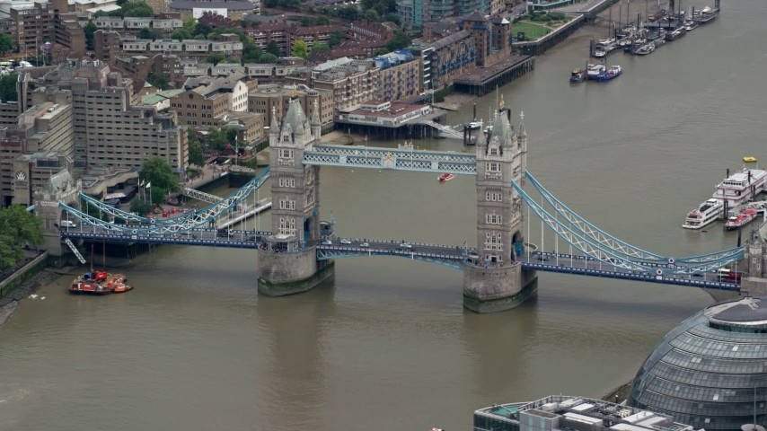 6K stock footage aerial video of light traffic on Tower Bridge spanning the River Thames, London, England Aerial Stock Footage | AX114_081