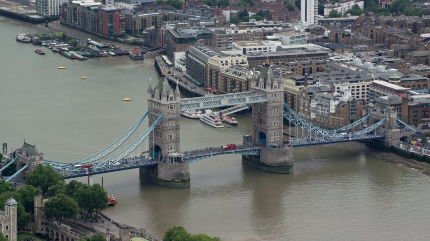 6K stock footage aerial video of orbiting Tower Bridge spanning River Thames, London, England Aerial Stock Footage | AX114_084