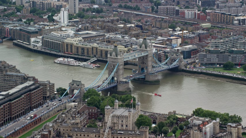6K stock footage aerial video of orbiting Tower Bridge and Tower of London, England Aerial Stock Footage | AX114_086