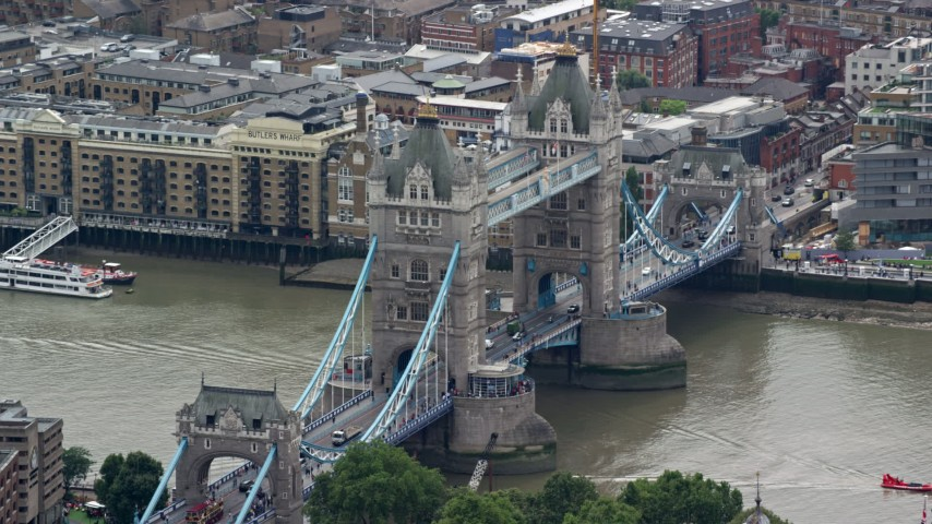 6K stock footage aerial video of orbiting by Tower Bridge spanning River Thames, London, England Aerial Stock Footage | AX114_087