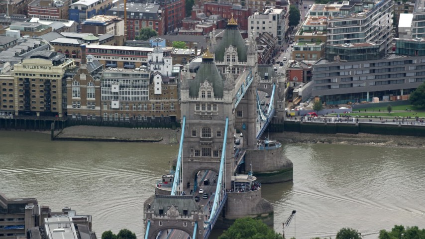 6K stock footage aerial video of orbiting the famous Tower Bridge over the River Thames, London, England Aerial Stock Footage | AX114_088