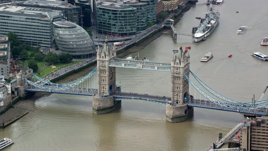 6K stock footage aerial video of orbiting the side of the Tower Bridge on River Thames in London, England Aerial Stock Footage | AX114_092