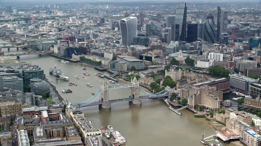 6K stock footage aerial video orbit the Tower Bridge on River Thames near skyscrapers, Central London, England Aerial Stock Footage | AX114_094
