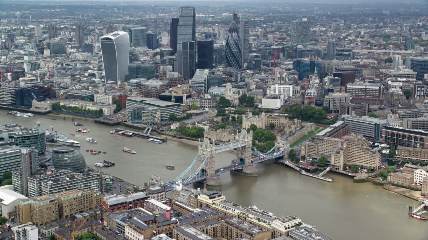 6K stock footage aerial video of Tower Bridge and Tower of London, skyscrapers in background, Central London, England Aerial Stock Footage | AX114_095