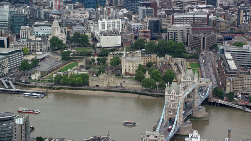 6K stock footage aerial video of Tower Bridge and Tower of London along the River Thames, London, England Aerial Stock Footage | AX114_096