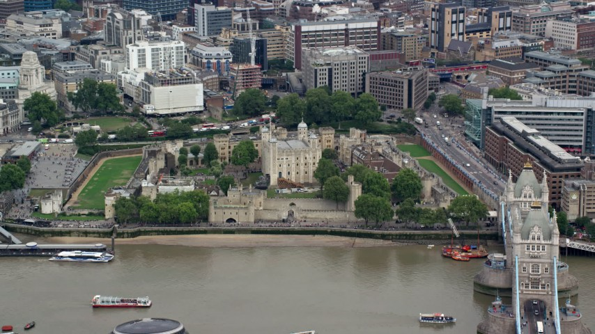 6K aerial video of orbiting Tower of London by River Thames and Tower Bridge, England Aerial Stock Footage | AX114_097