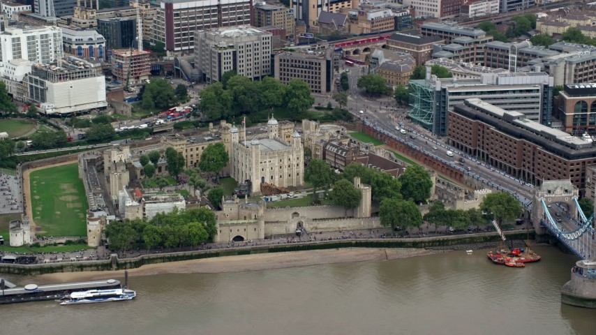 6K stock footage aerial video of iconic Tower of London overlooking the River Thames, England Aerial Stock Footage | AX114_098