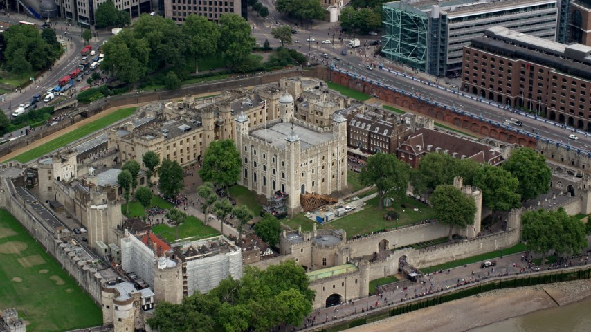 6K stock footage aerial video of flying by the iconic Tower of London, England Aerial Stock Footage | AX114_100