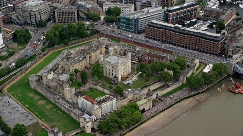 6K stock footage aerial video approach Tower of London overlooking the river, England Aerial Stock Footage | AX114_101