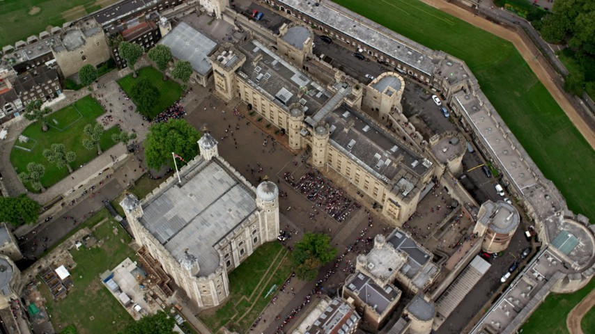 6K stock footage aerial video of a bird's eye view of Tower of London with crowds of tourists, England Aerial Stock Footage | AX114_103