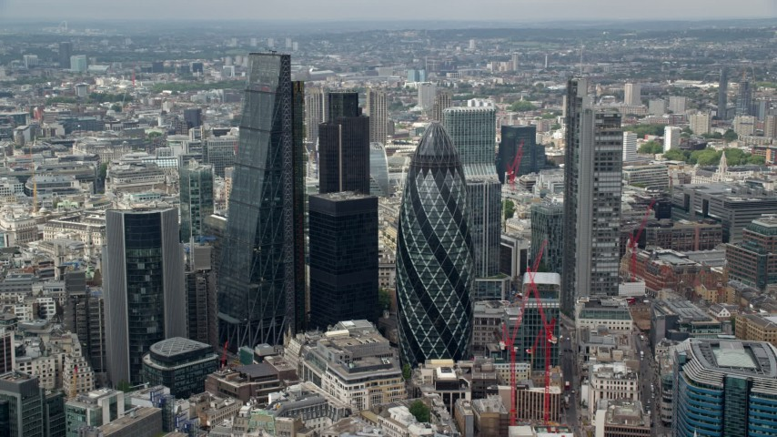 6K stock footage aerial video of orbiting The Gherkin and skyscrapers in Central London, England Aerial Stock Footage | AX114_104
