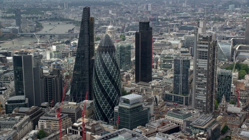 6K stock footage aerial video of orbiting around The Gherkin and city skyscrapers, Central London, England Aerial Stock Footage AX114_106