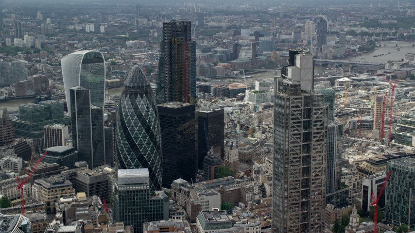 6K stock footage aerial video of orbiting The Gherkin and Heron Tower skyscrapers, London, England Aerial Stock Footage | AX114_108
