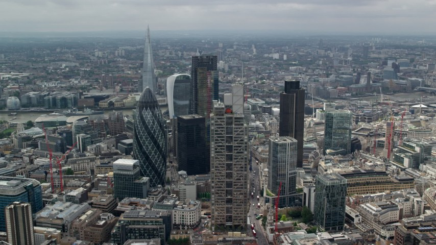 6K stock footage aerial video orbiting group of skyscrapers, The Shard in the background, Central London, England Aerial Stock Footage | AX114_109