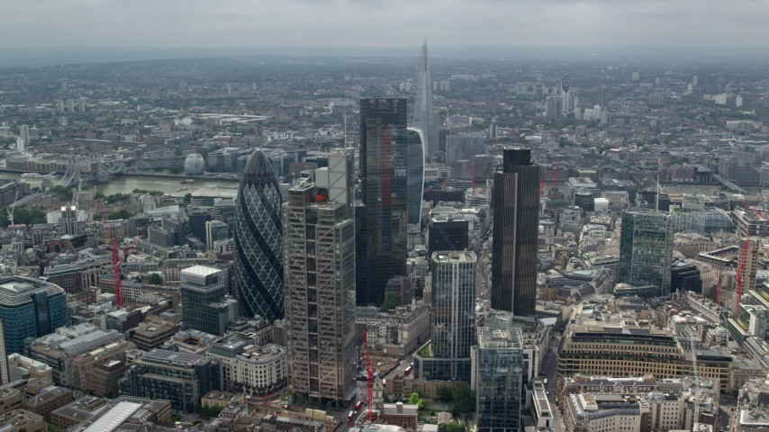 6K aerial video of an orbit of skyscrapers in Central London, England, and The Shard in the background Aerial Stock Footage | AX114_110