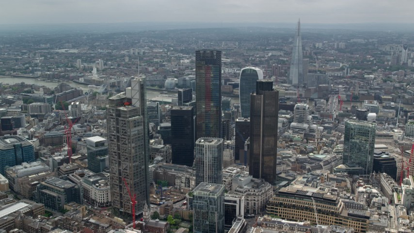 6K stock footage aerial video of circling the skyscrapers in Central London, England, The Shard in the background Aerial Stock Footage | AX114_111