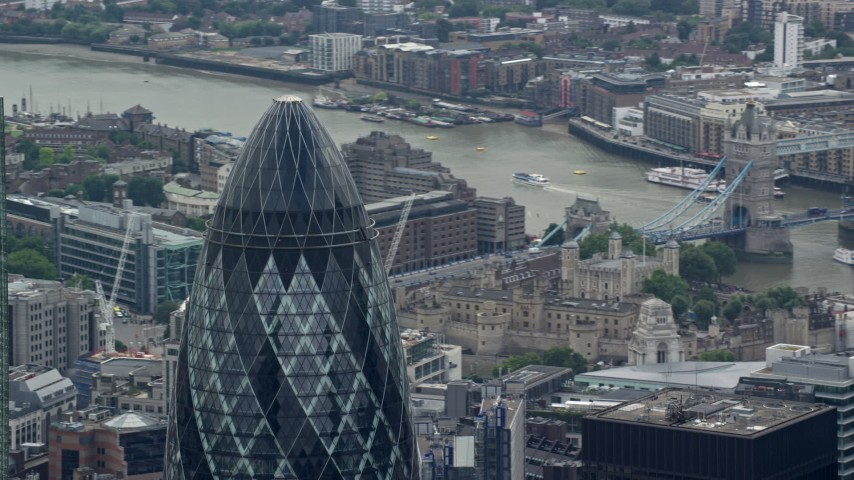 6K stock footage aerial video orbiting the top of The Gherkin skyscraper, Central London, England Aerial Stock Footage | AX114_112