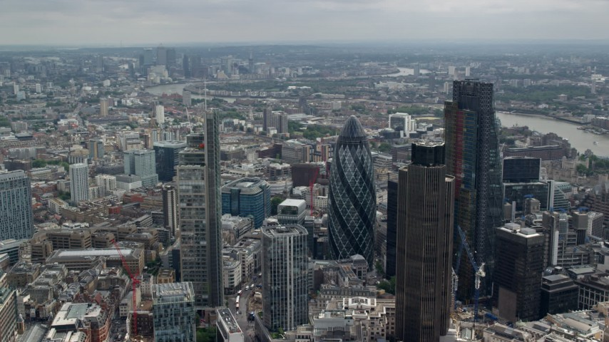 6K stock footage aerial video orbiting Central London skyscrapers and city sprawl, England Aerial Stock Footage | AX114_113