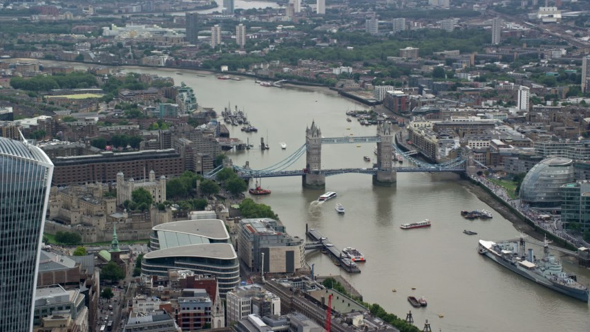 6K stock footage aerial video of Tower of London, and Tower Bridge on River Thames, England Aerial Stock Footage | AX114_114