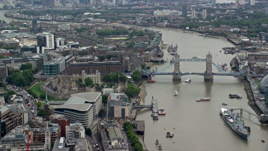 6K stock footage aerial video of iconic Tower of London, and Tower Bridge on the River Thames, England Aerial Stock Footage | AX114_115
