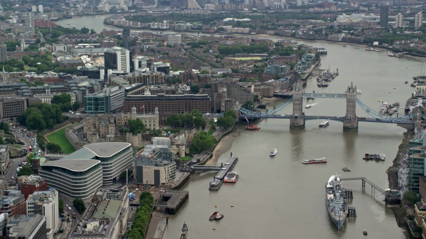 6K stock footage aerial video of historic Tower of London, and Tower Bridge on River Thames, England Aerial Stock Footage   AX114_116