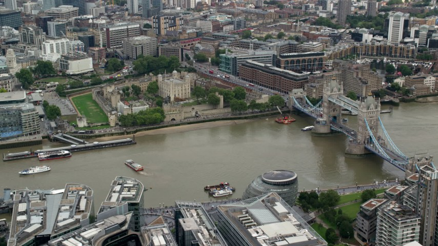 6K stock footage aerial video of passing the Tower of London and Tower Bridge over the River Thames, England Aerial Stock Footage | AX114_120