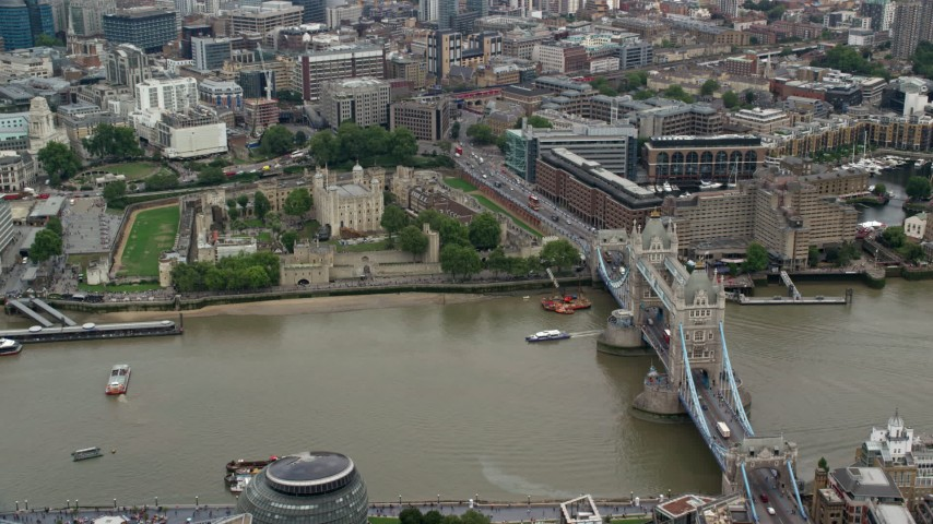 6K stock footage aerial video of Tower of London with view of Tower Bridge and River Thames, England Aerial Stock Footage | AX114_121