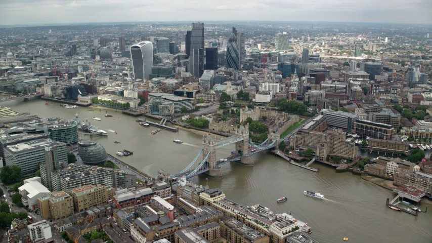 6K stock footage aerial video wide view of Tower Bridge near Tower of London and Central London skyscrapers, England Aerial Stock Footage | AX114_123