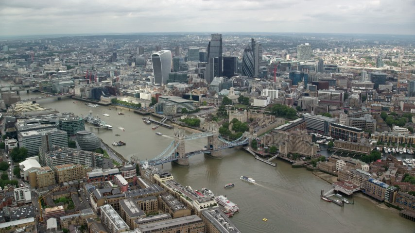 6K stock footage aerial video of the Tower Bridge and Central London skyscrapers near the river, England Aerial Stock Footage | AX114_124
