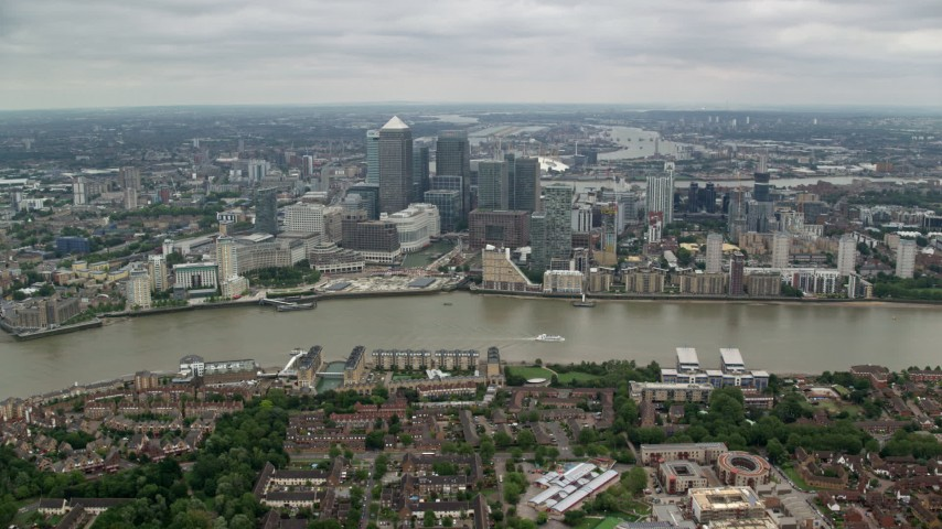 6K stock footage aerial video of Canary Wharf skyscrapers on the opposite side of the River Thames, London, England Aerial Stock Footage | AX114_128