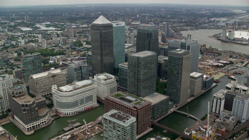 6K stock footage aerial video of flying by Canary Wharf skyscrapers, London, England Aerial Stock Footage | AX114_131
