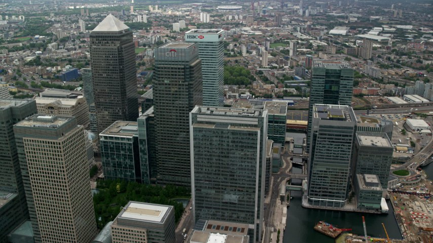 6K stock footage aerial video of an orbit of skyscrapers at Canary Wharf, London, England Aerial Stock Footage | AX114_134