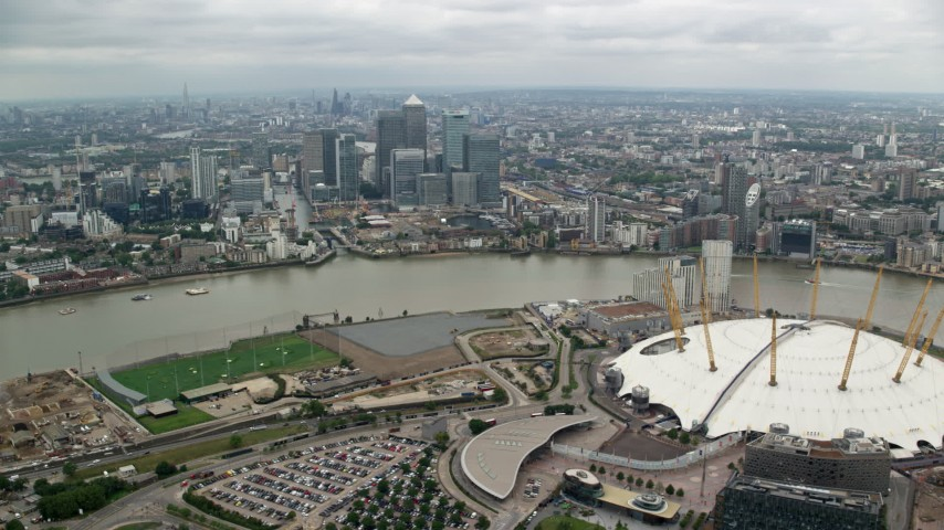 6K stock footage aerial video of the O2 arena and Canary Wharf skyscrapers, London, England Aerial Stock Footage | AX114_139