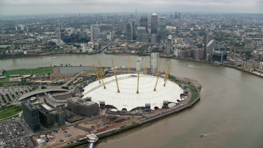 6K stock footage aerial video of O2 Arena with Canary Wharf skyscrapers in background, London, England Aerial Stock Footage | AX114_141