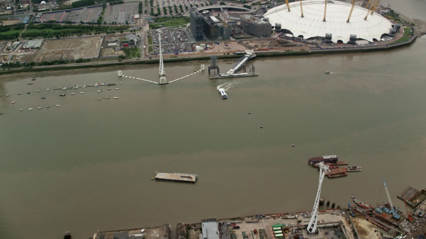 6K stock footage aerial video of orbit Emirates Air Line gondolas and reveal The O2 arena, London, England Aerial Stock Footage | AX114_143