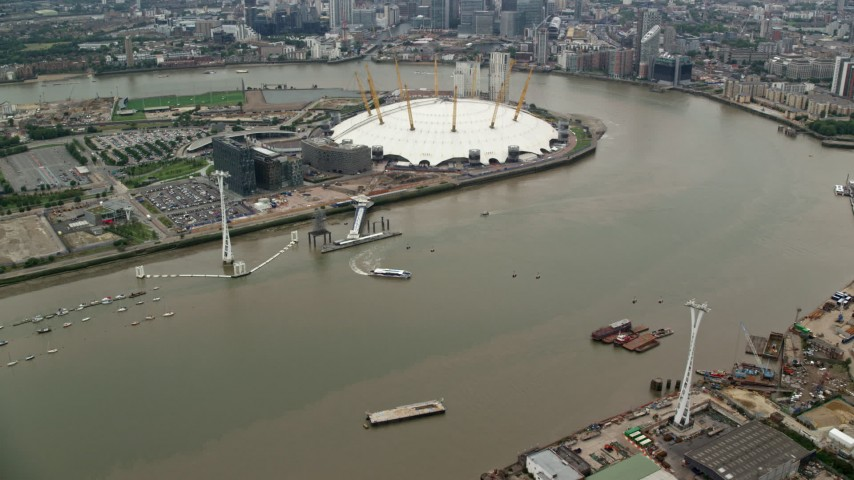 6K stock footage aerial video orbit Emirates Air Line gondolas near The O2 Arena, London, England Aerial Stock Footage | AX114_144