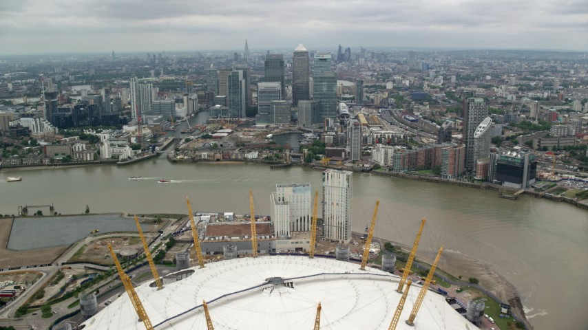 6K stock footage aerial video fly over O2 arena, approach Canary Wharf skyscrapers, London, England Aerial Stock Footage | AX114_147