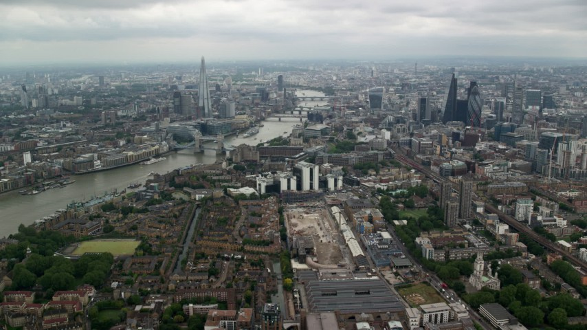 6K stock footage aerial video approach The Shard and Central London skyscrapers by River Thames, England Aerial Stock Footage | AX114_157