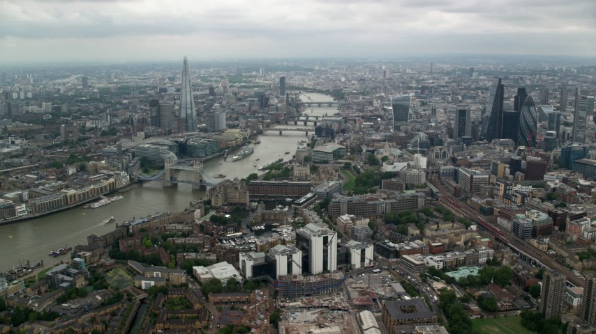 6K aerial video approach The Shard and River Thames bridges in London, England Aerial Stock Footage | AX114_158