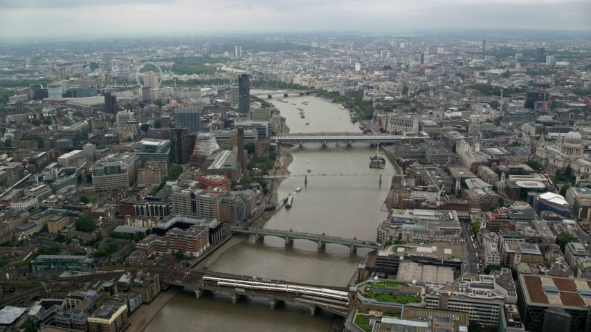 6K stock footage aerial video of flying over bridges spanning the River Thames, London, England Aerial Stock Footage | AX114_162